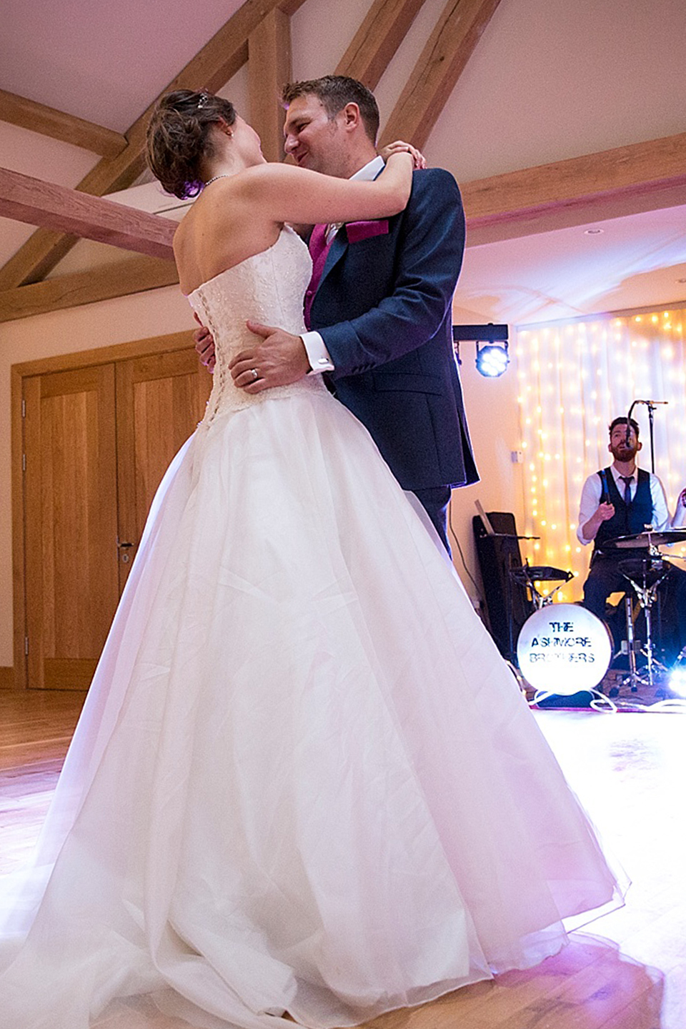 The newlyweds have their first dance as husband and wife inside the stunning barn wedding venue