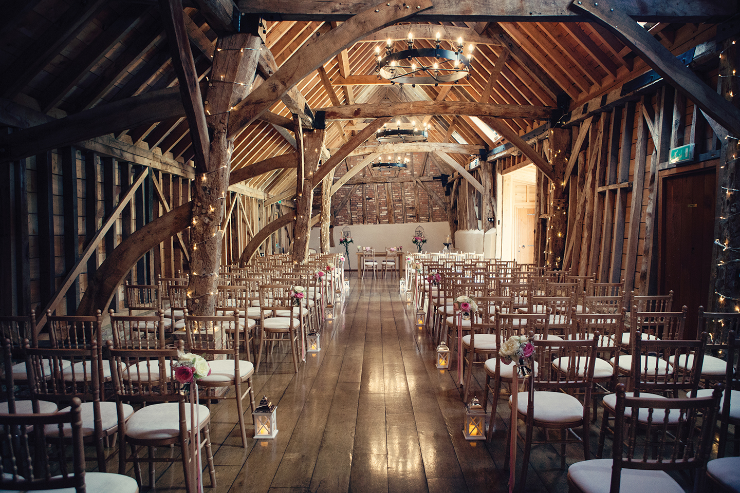 The Rickety Barn at Bassmead Manor Barns wedding venue is set up for a rustic wedding ceremony