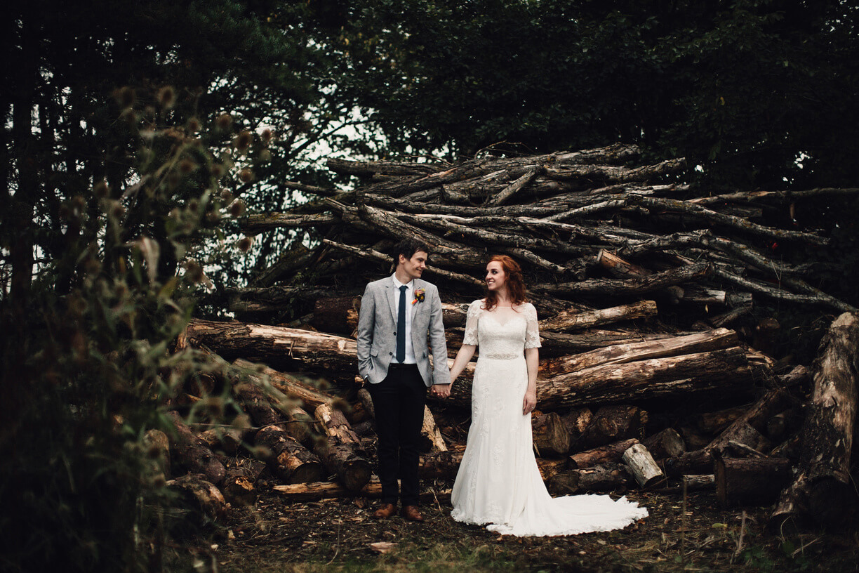 A bride and groom explore this Cambridgeshire wedding venue on their autumn wedding day