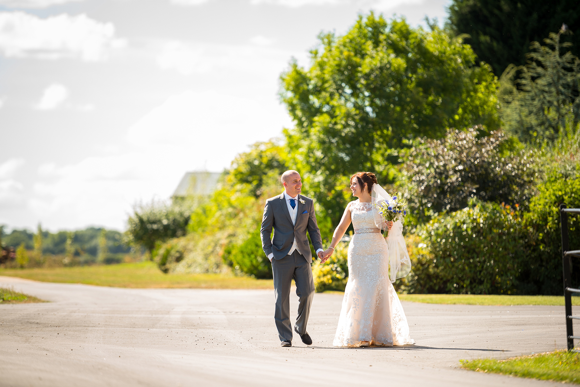 The bride and groom steal a moment away from guests to reflect on their happy wedding day