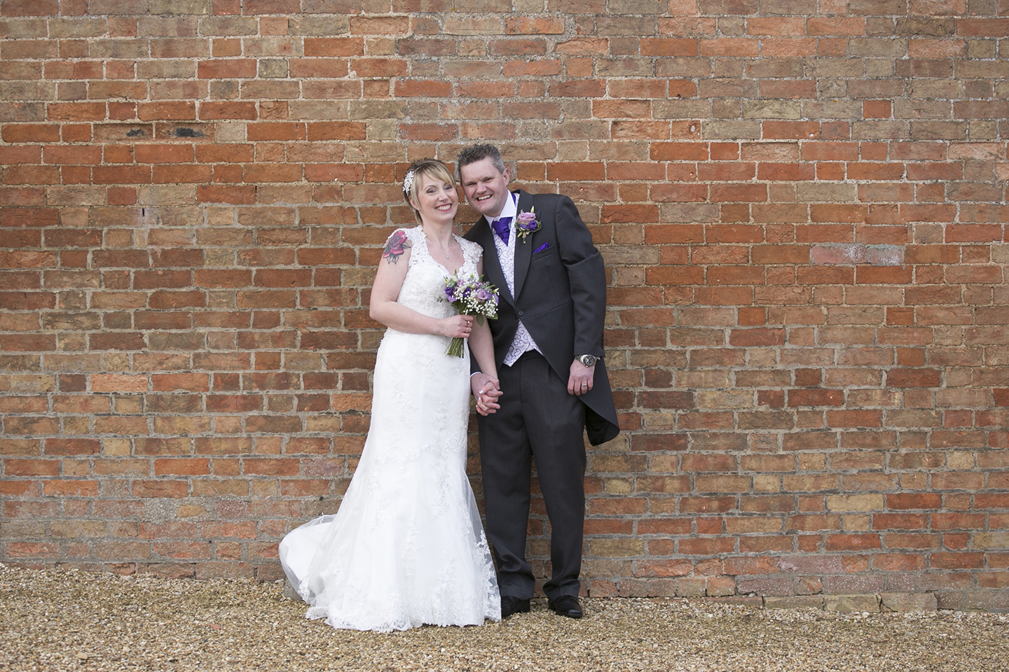 The bride and groom take a moment away from guests on their wedding day at Bassmead Manor Barns