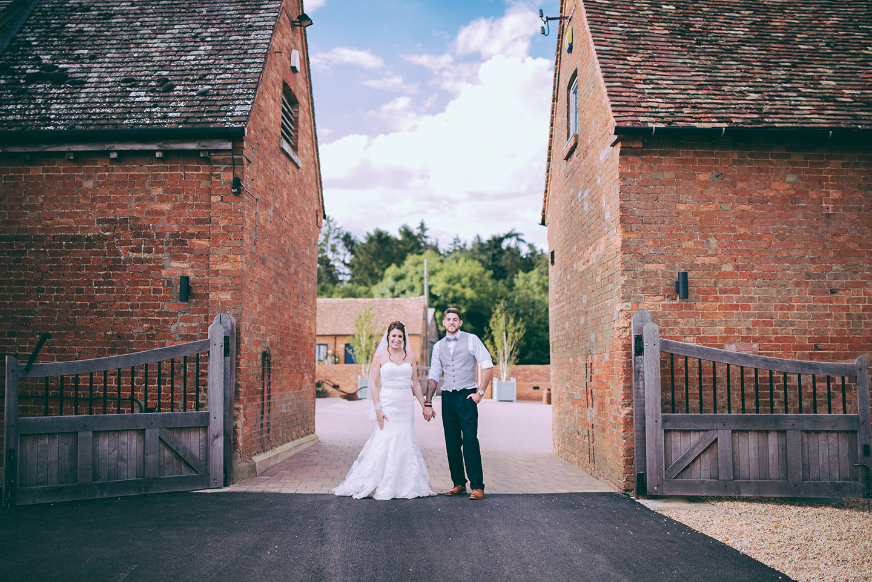 A bride and groom explore this Cambridgeshire barn wedding venue on their wedding day