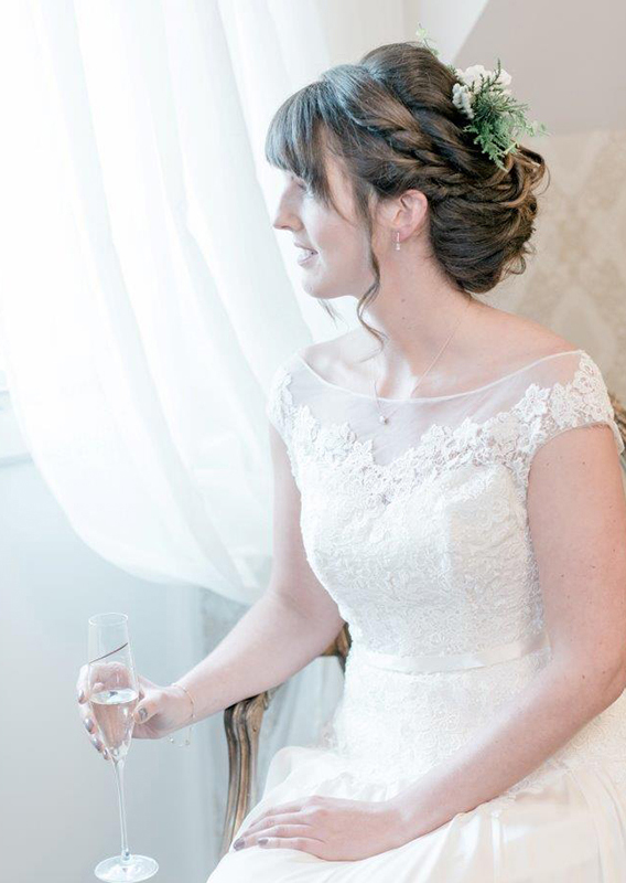 The bride gets ready in the Bridal Boudoir wearing her beautiful wedding dress