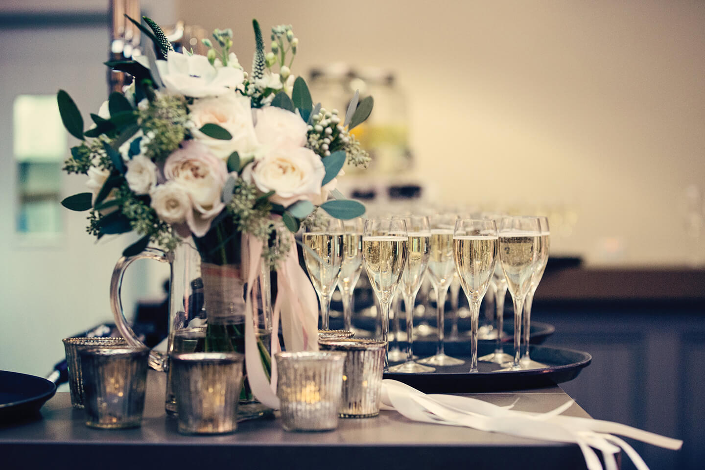 Glasses of champagne await guests during the wedding reception – winter wedding ideas