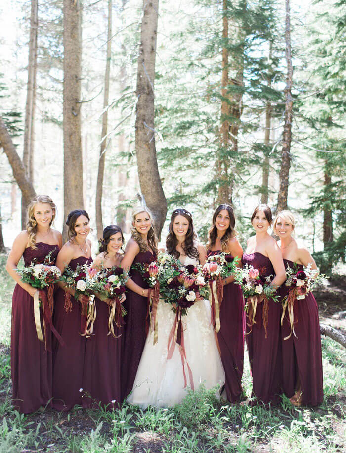 Plum bridesmaid dresses and bouquets are perfect for an autumn wedding
