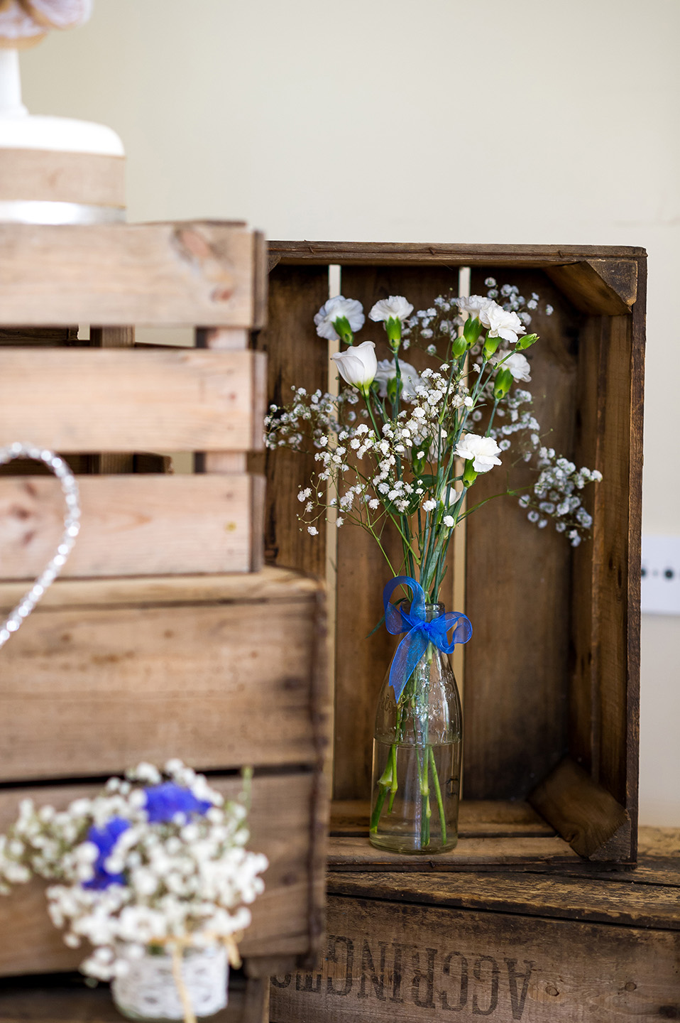 Apple crates were stacked and decorated with wedding flowers