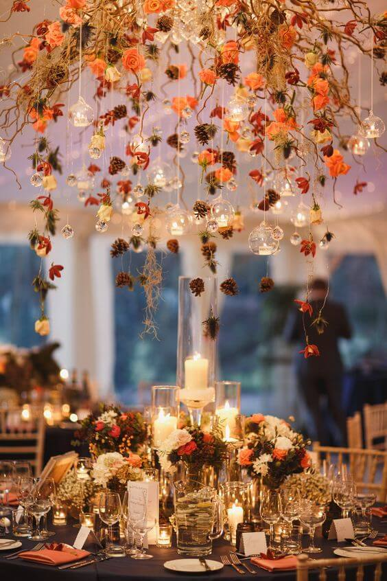 Decorate tables with autumn flowers and candles for a cosy autumn feel
