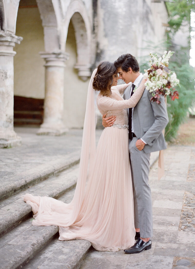 Shades of champagne or blush pink are an alternative colour to choose for an autumn wedding dress