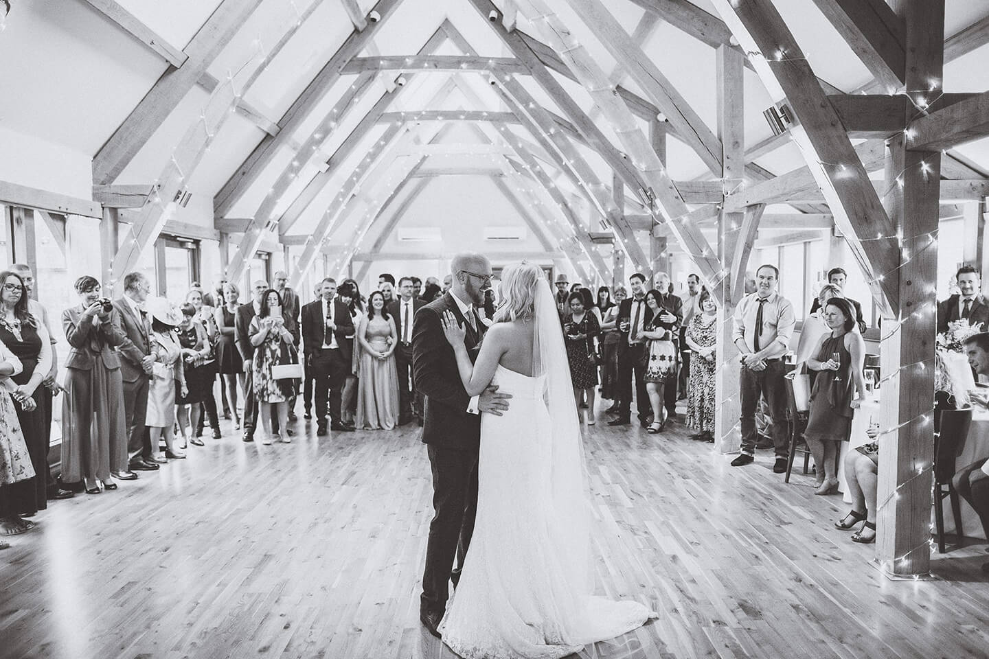 The happy couple enjoy their first dance as husband and wife in the beautiful Bridge Barn