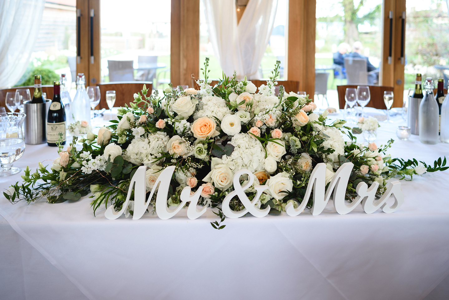 Beautiful white flowers were on display throughout the venue including the top table – wedding ideas