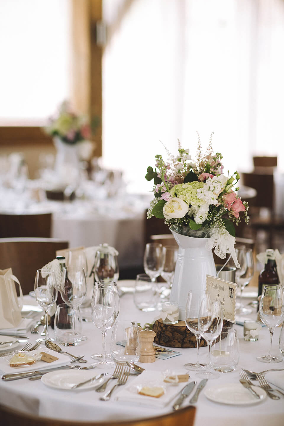 Floral table centrepieces created a rustic wedding look