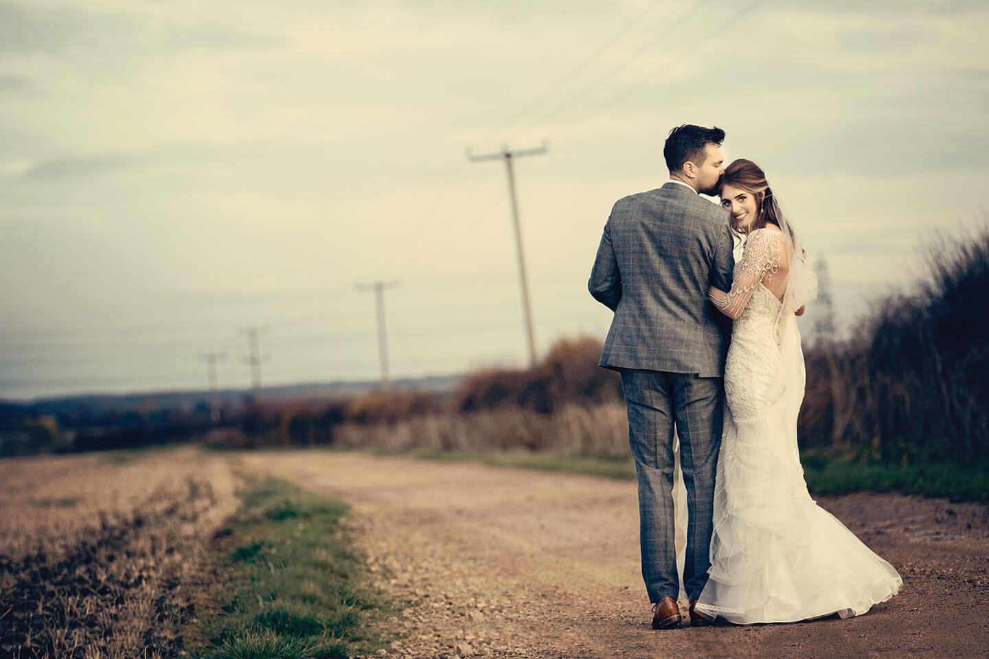 The loved-up couple stroll through the countryside setting at one of the finest wedding venues in Cambridgeshire