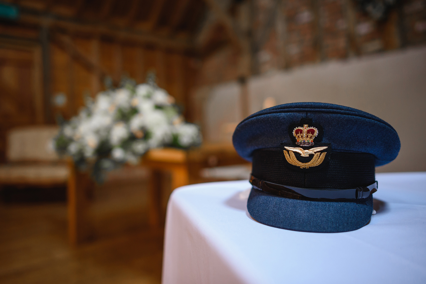 A close up of the groom's military hat to accompany his military suit – wedding ideas