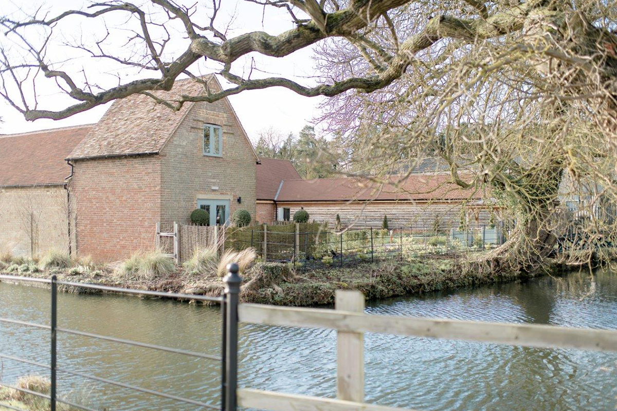 The beautiful Cambridgeshire wedding barn has a moat run around the outside - wedding venues Cambridgeshire