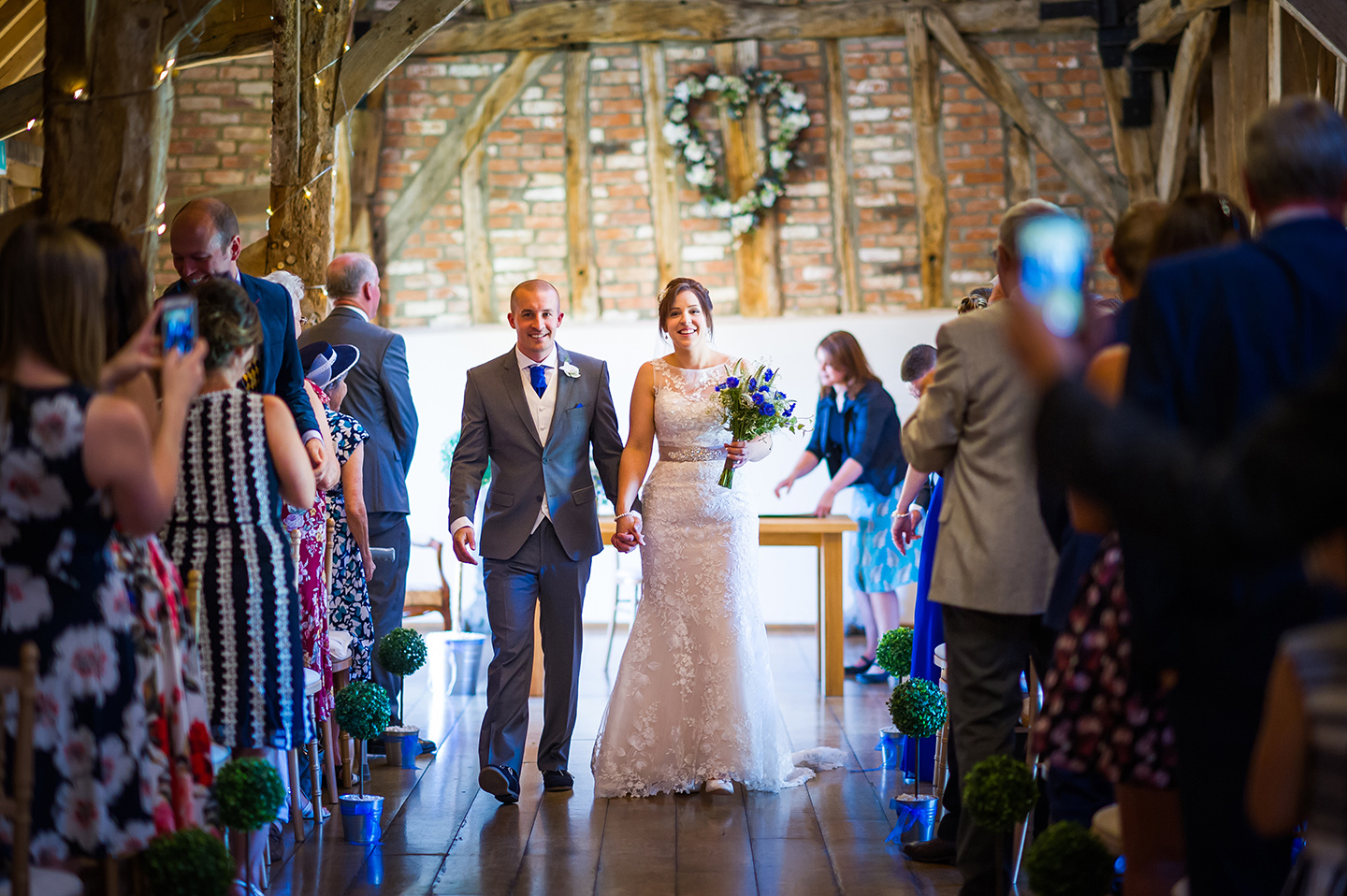 The bride and groom exchanged wedding vows in the beautiful Rickety Barn wedding ceremony barn