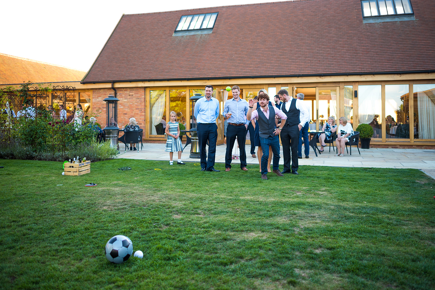 Guests were entertained with outdoor garden games in the pretty gardens