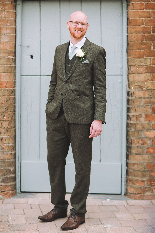 The groom looked smart in a dark grey tweed suit