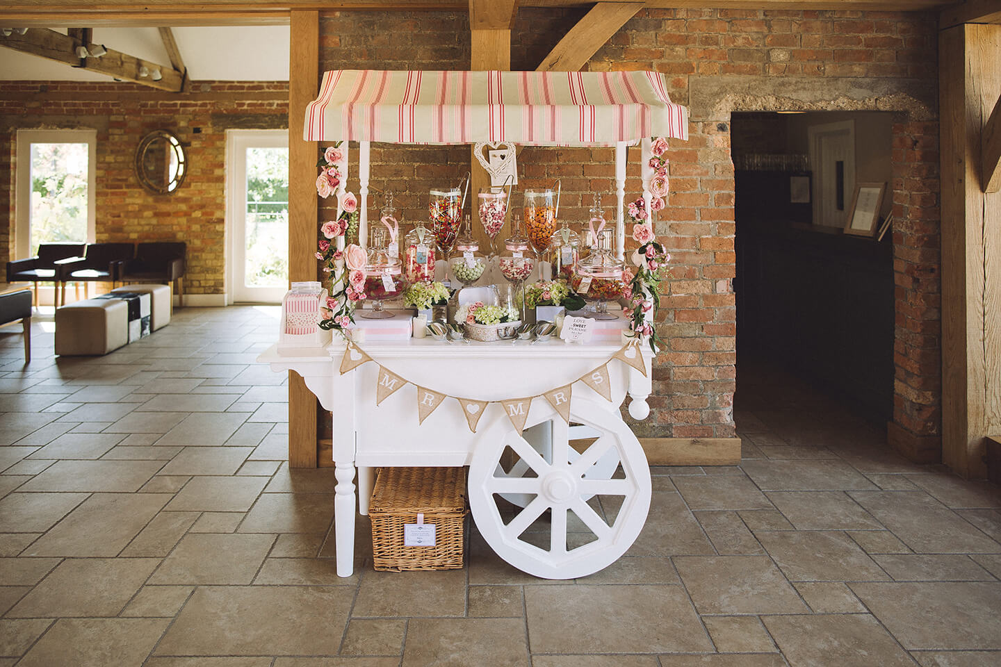 Guests were treated to a white sweet cart in the Moat Barn – wedding ideas