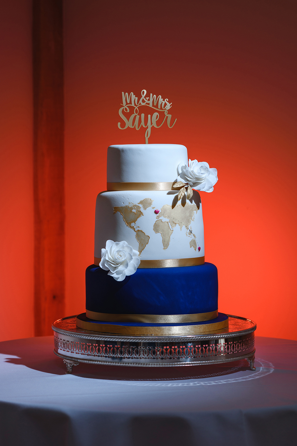 The couple's three-tier wedding cake featured a navy coloured cake at the bottom and map detail on the middle tier