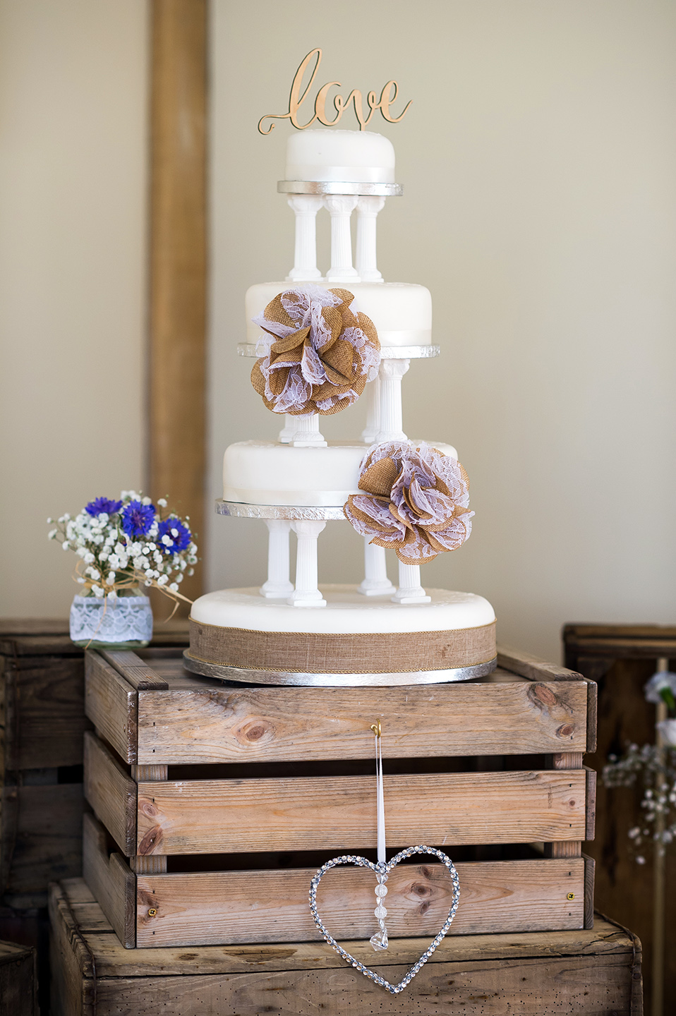 The couple had a three-tier wedding cake decorated to complement their rustic wedding theme