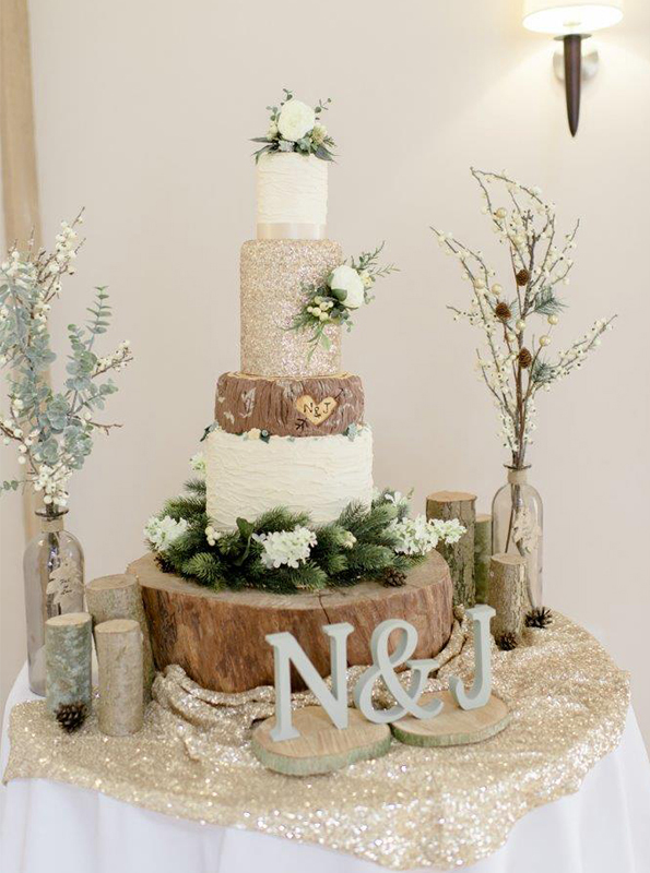 The couple surprised guests with a stunning woodland wedding cake stood upon a tree stump – rustic wedding theme