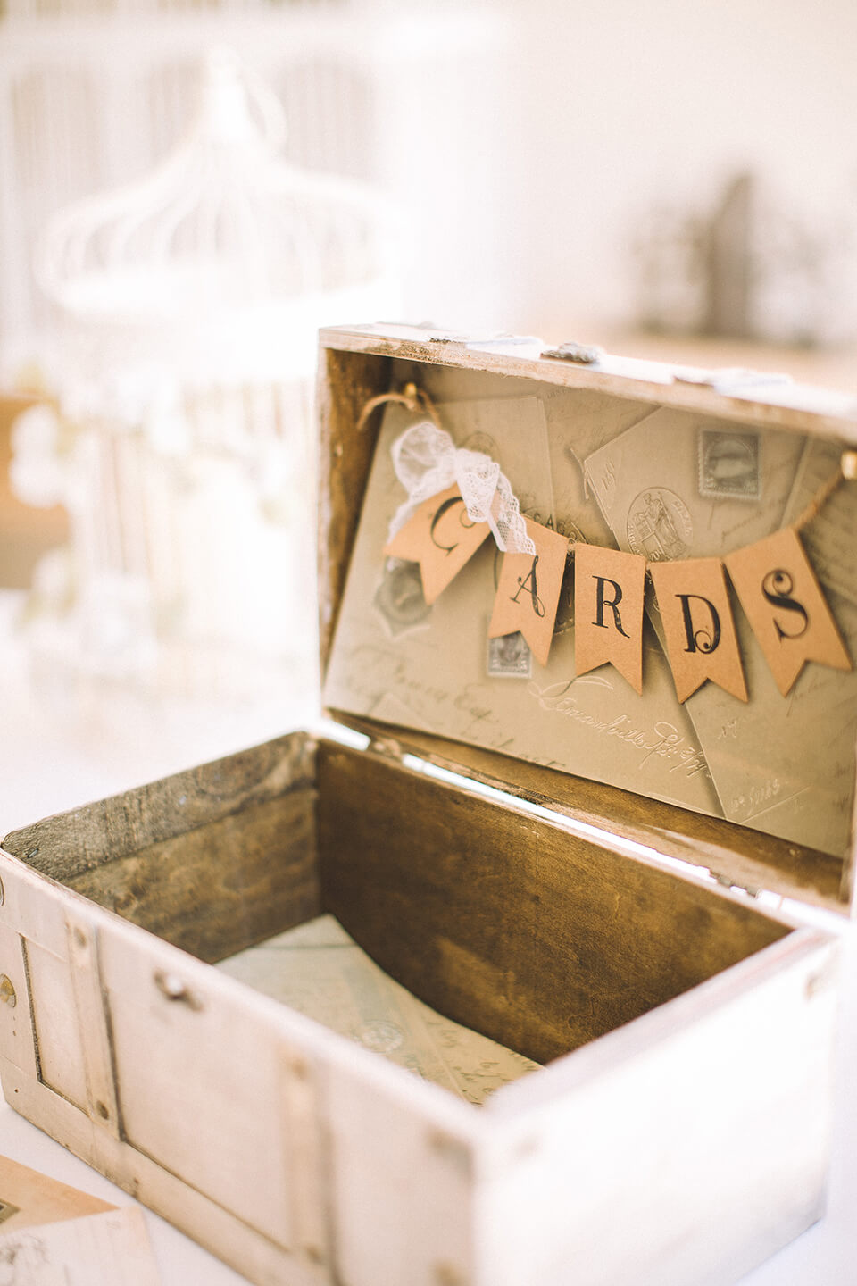 A suit case is decorated with wedding bunting for guests to leave their cards and gifts