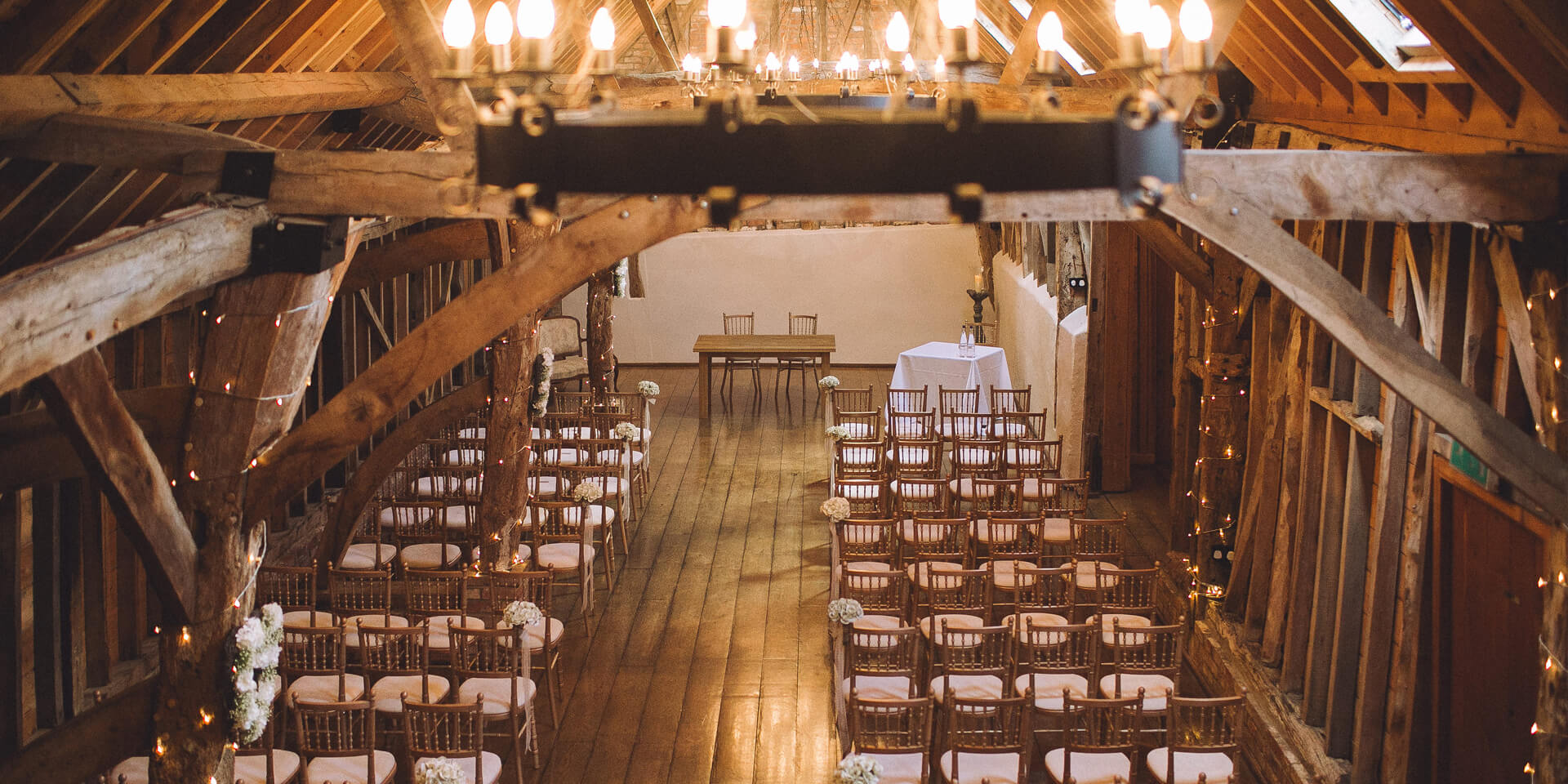 The couple held their wedding ceremony in the intimate Rickety Barn decorated with white flowers