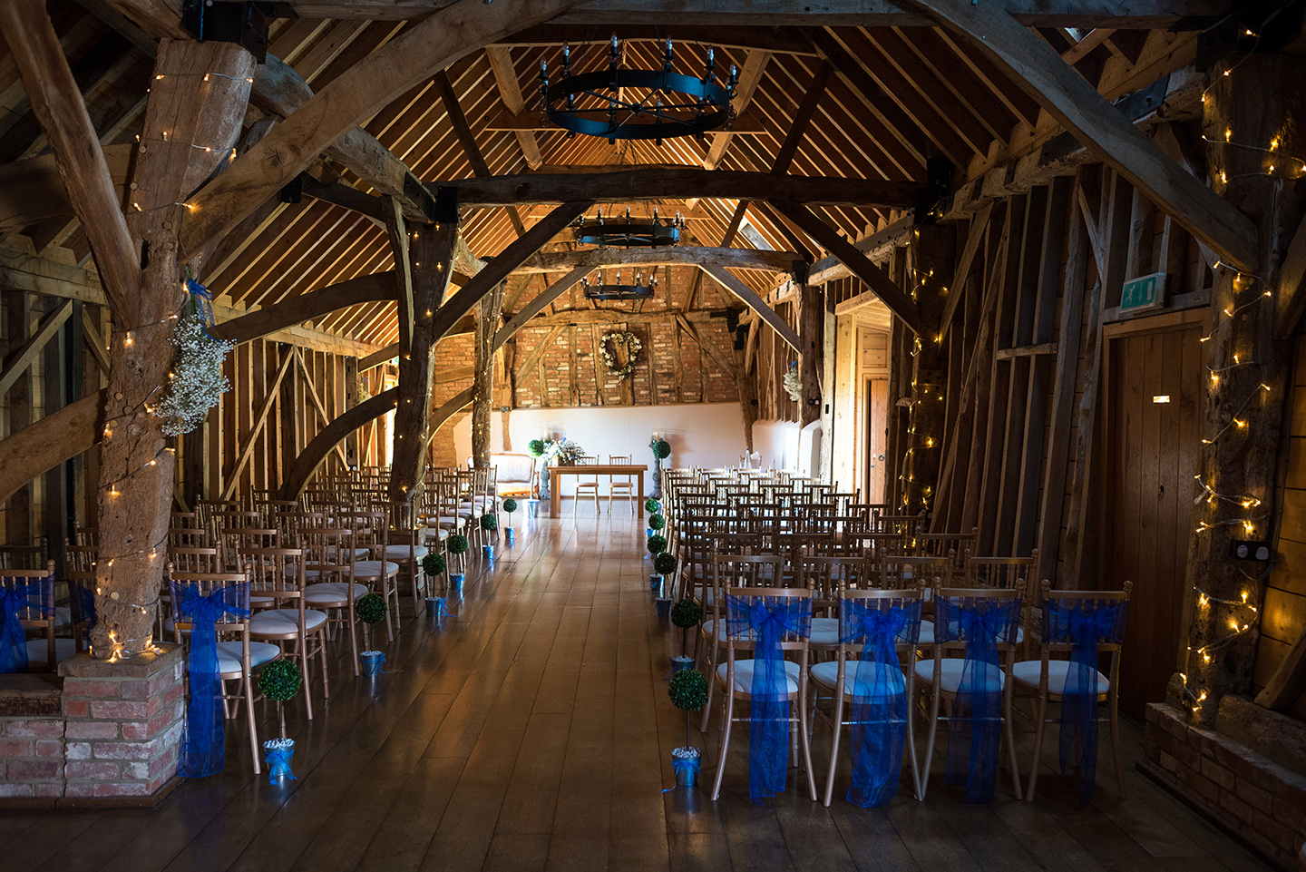 The Rickety Barn looked beautiful set up for the wedding ceremony with the chairs decorated with blue sashes