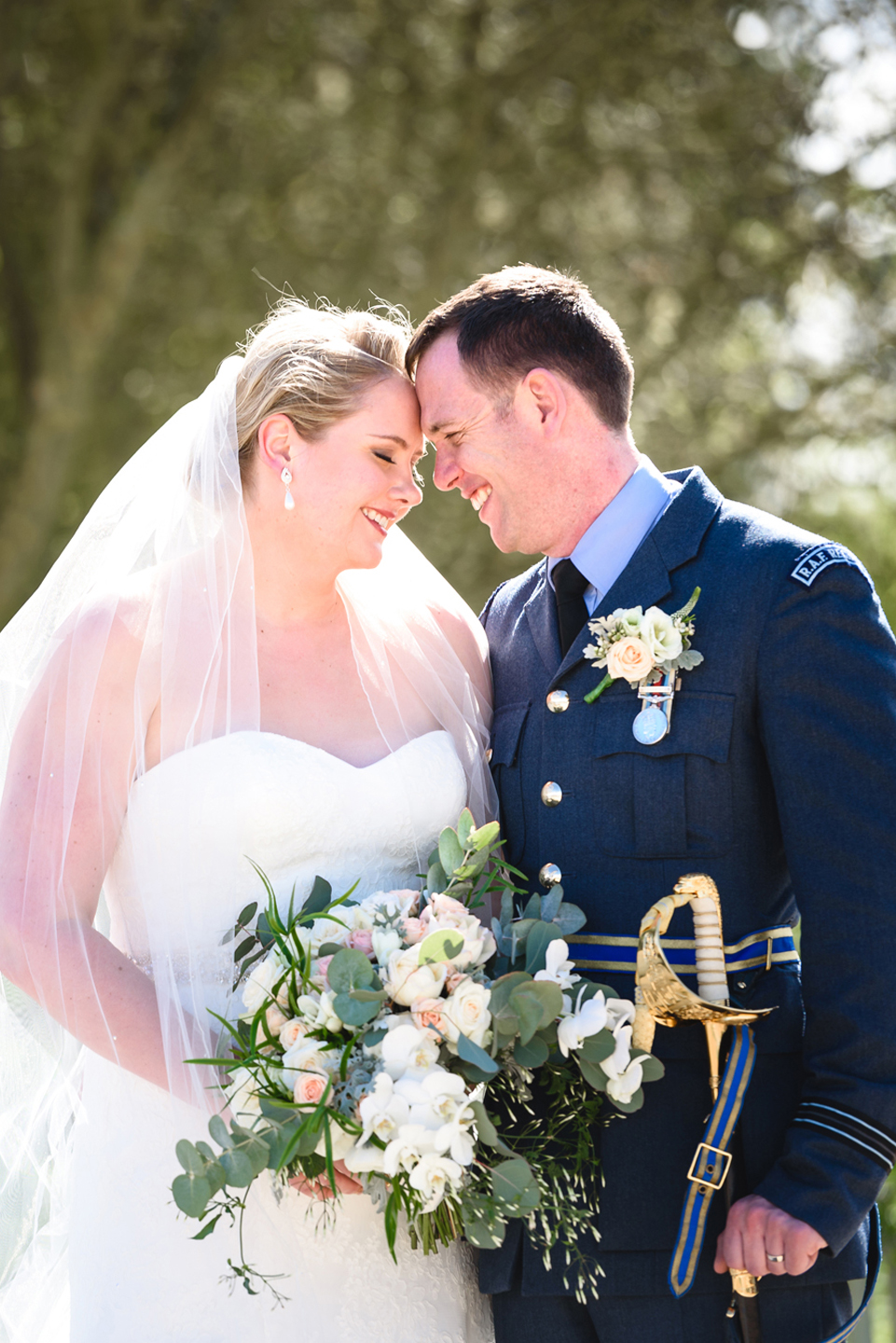 The happy couple steal a moment away from guests to stroll around their country wedding venue