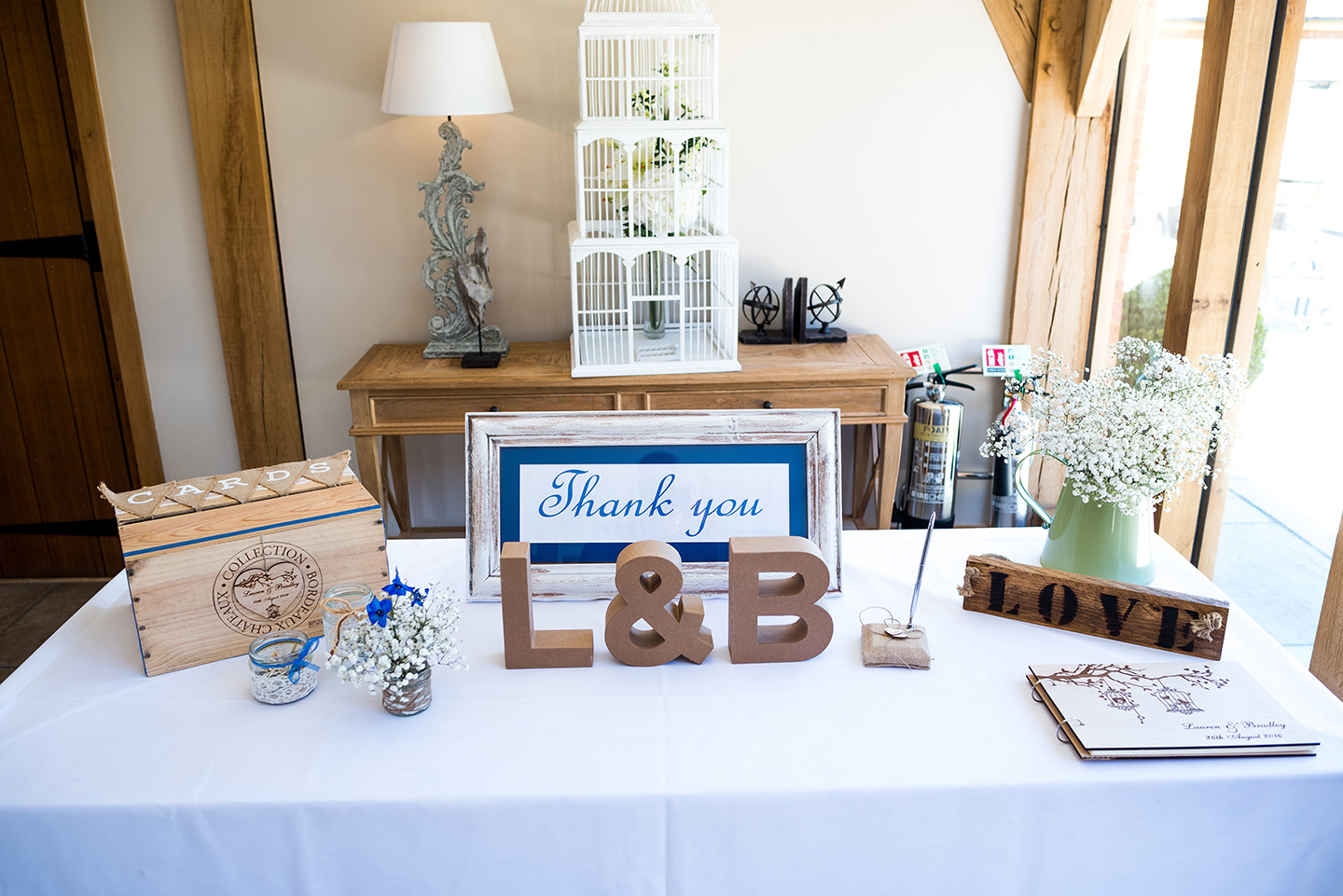 Inside the barn a table was decorated with gypsophila and featured a wedding guest book and card box