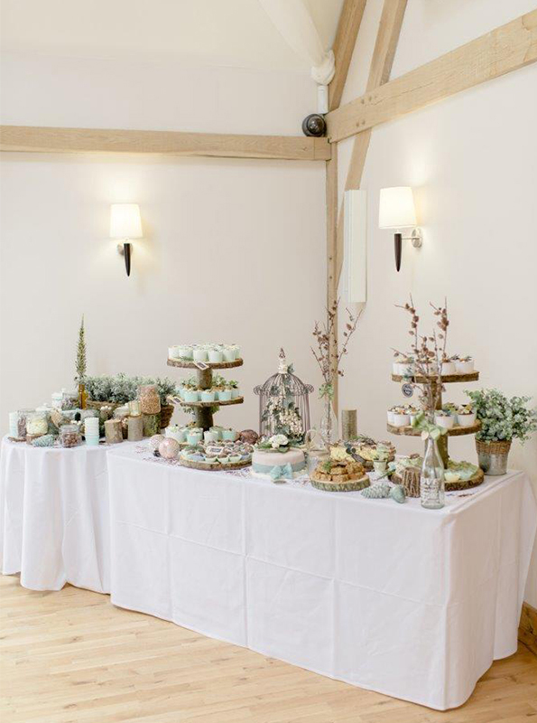 Guests were treated to a dessert table adorned with cakes decorated to suit their woodland themed wedding