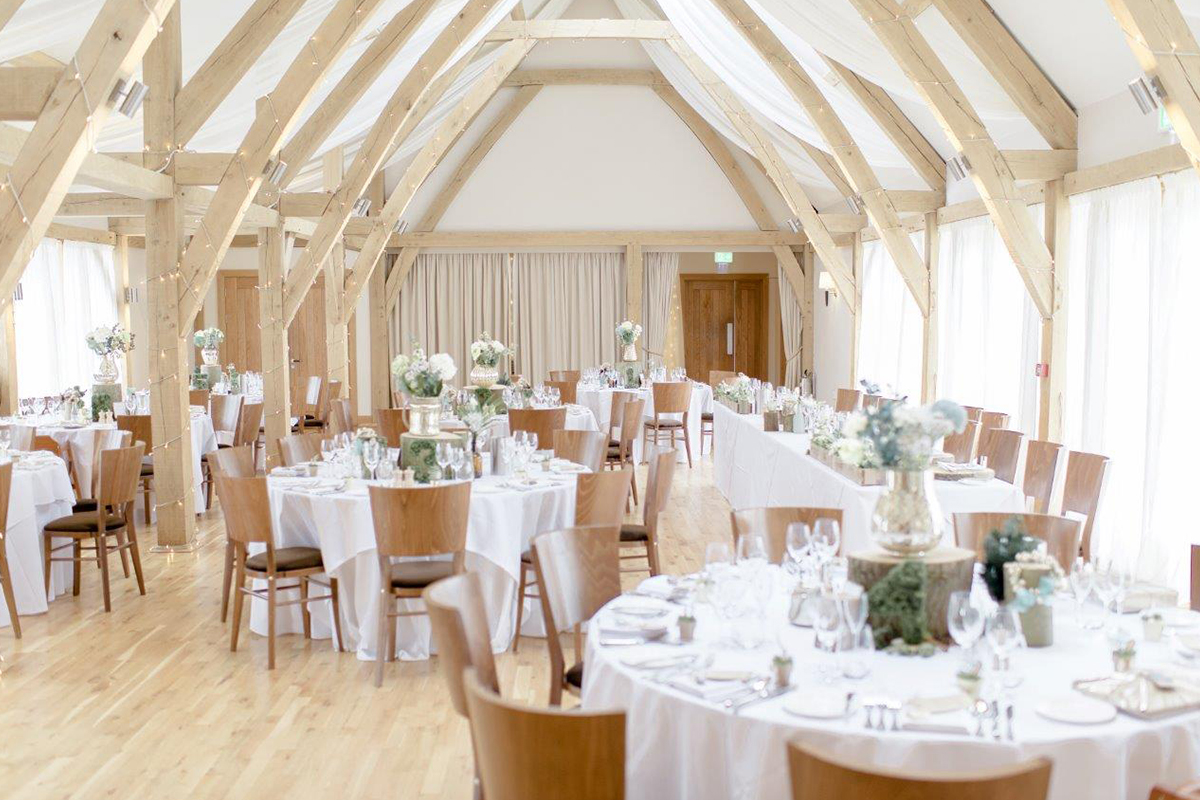 The Moat Barn was the perfect light and airy space for the couple's woodland themed wedding reception