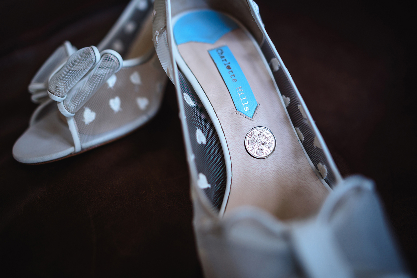 The bride wore wedding shoes which had a mesh fabric embroidered with white hearts and a bow
