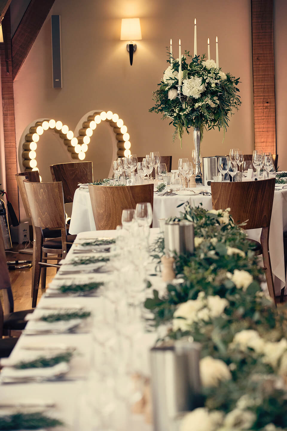 The couple brought the outside in on their wedding day with natural foliage adorning the tables for the wedding breakfast