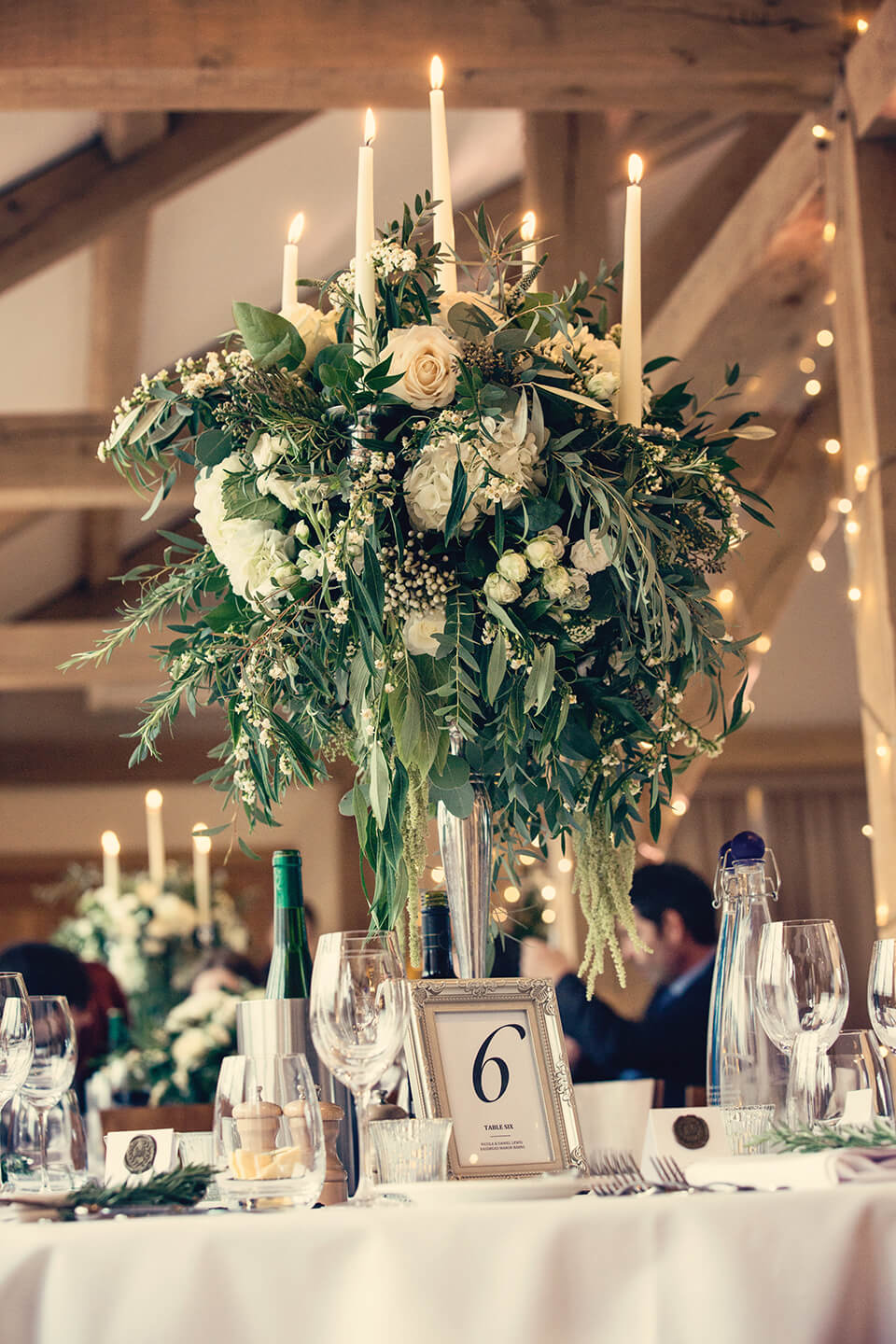 Huge flower arrangements decorated the candelabras on each of the tables – wedding ideas