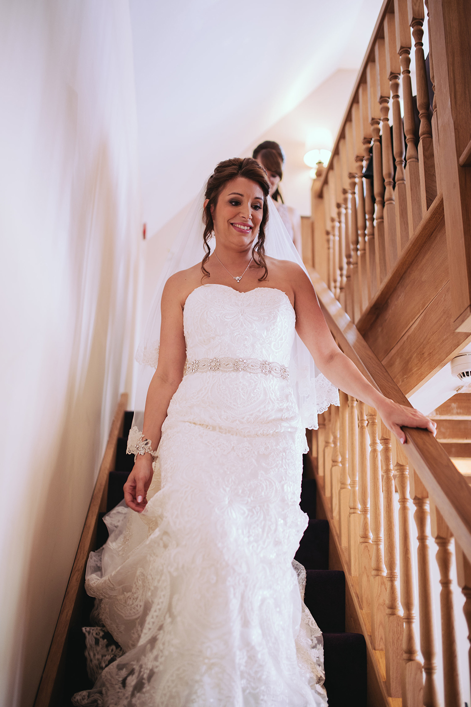 The bride wore a lace fit and flare wedding dress for her summer wedding at Bassmead Manor Barns