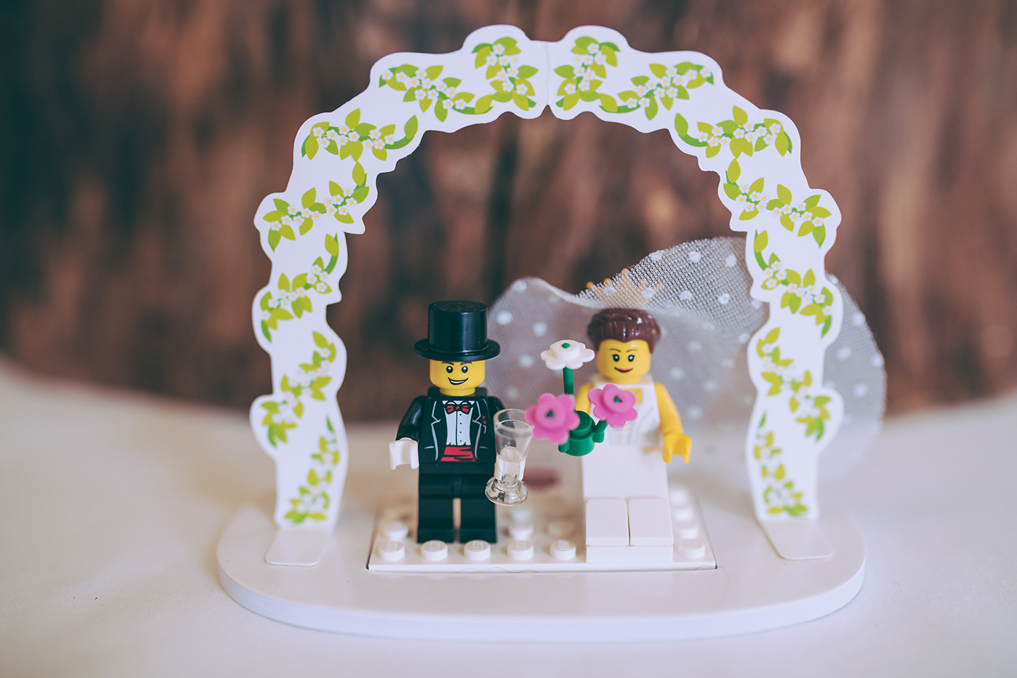 The couple had a lego cake topper for their summer wedding at Bassmead Manor Barns