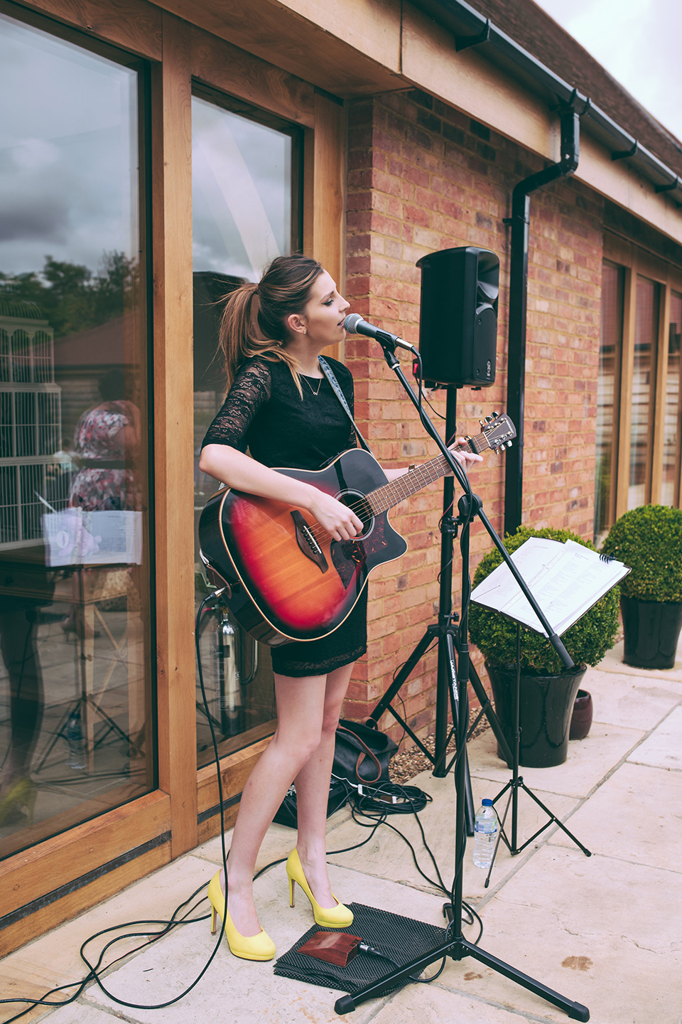 For their wedding entertainment at Bassmead Manor Barns the newlyweds had an acoustic singer