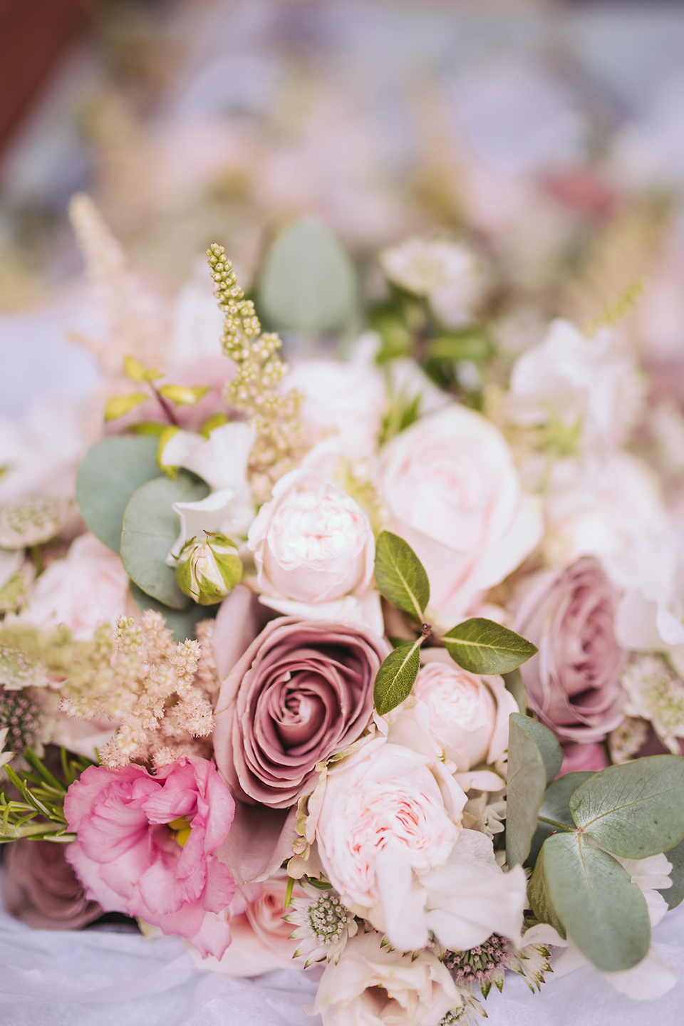 The couple chose pink wedding flowers for her summer wedding at Bassmead Manor Barns
