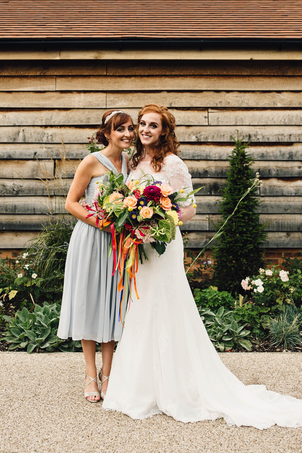 The bridesmaid wore a pale blue knee length bridesmaid dress for this festival themed wedding