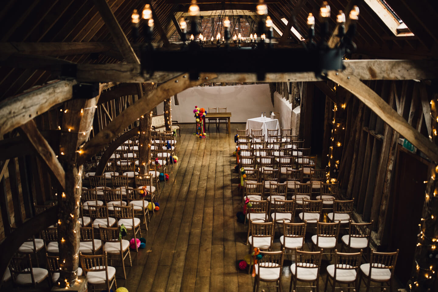 The Rickety Barn is set up for a festival themed wedding ceremony