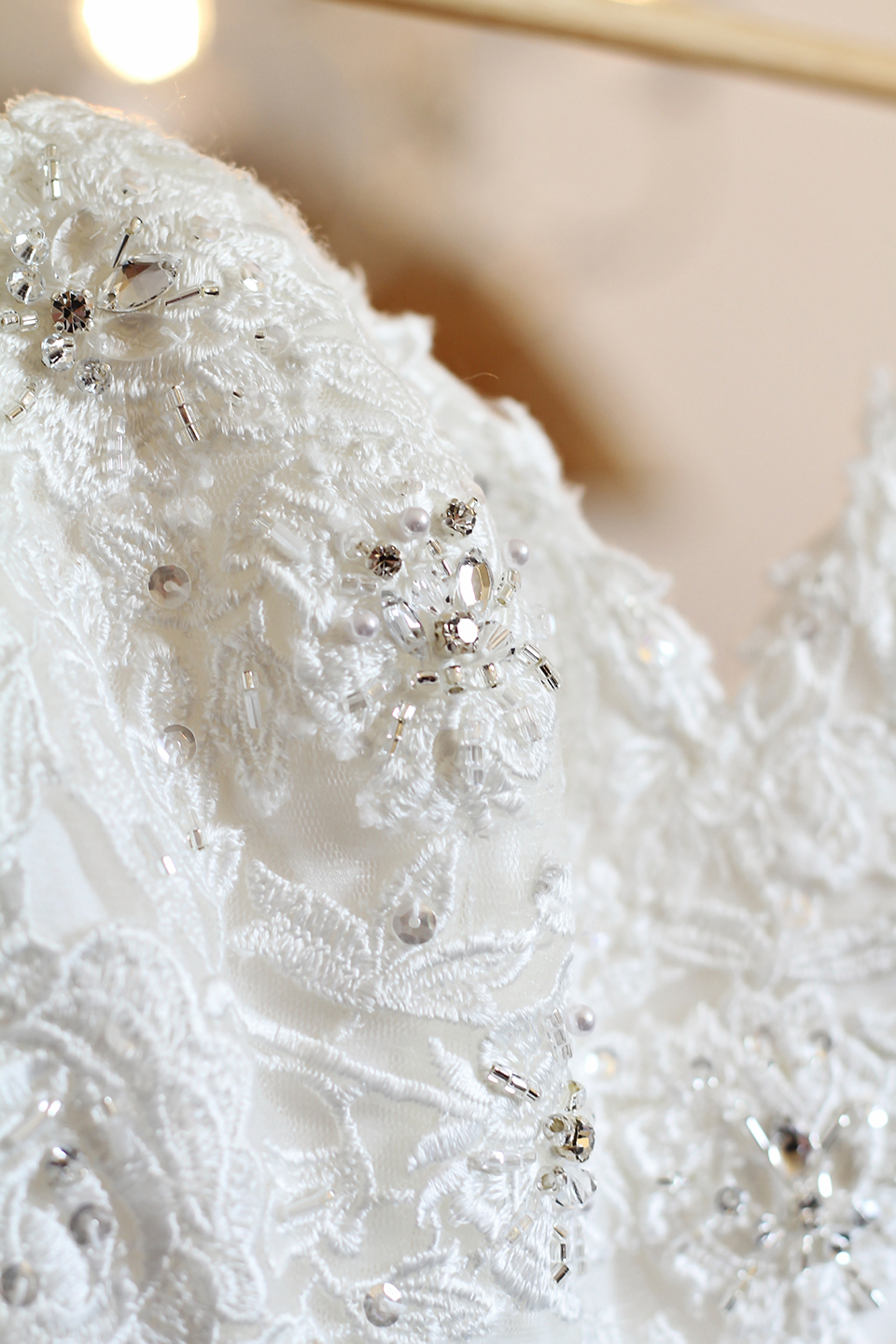 The brides dress was detailed with lace and crystals for her wedding at Bassmead Manor Barns