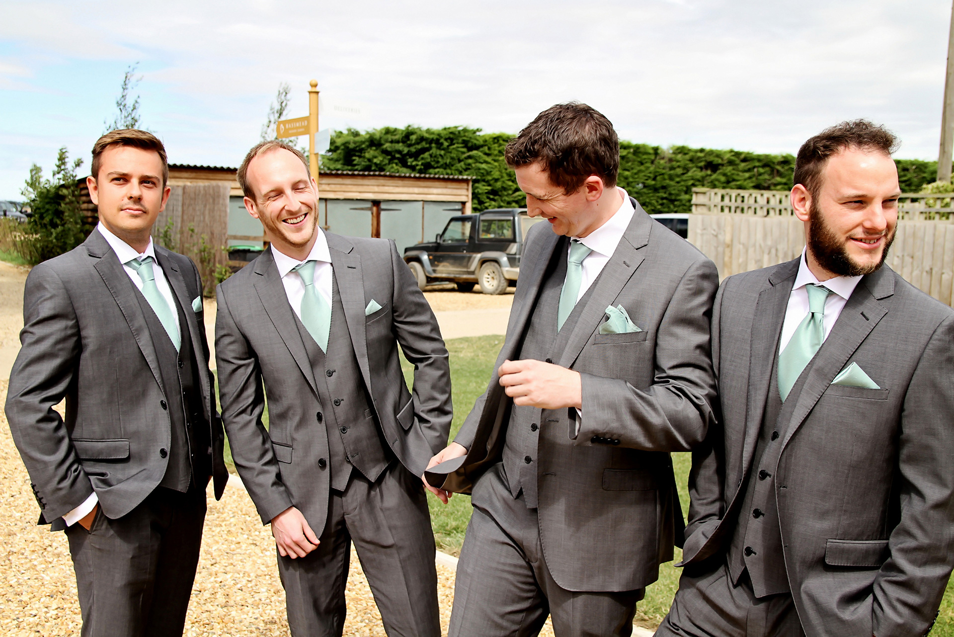 The groom and his groomsmen wore grey suits and mint green ties for his wedding at Bassmead Manor Barns