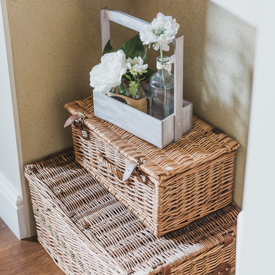 Hamper baskets and pretty flowers at Bassmead Manor Barns wedding accommodation in Cambridgeshire