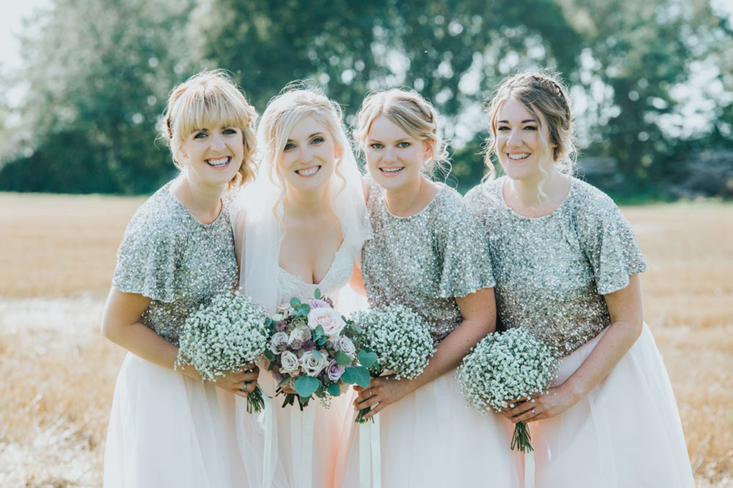 Bridesmaids wore sequin bridesmaids dresses for this glamourous wedding at Bassmead Manor Barns