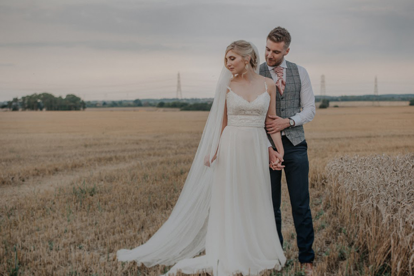 The bride and groom make the most of the countryside that surrounds Bassmead Manor Barns on their wedding day