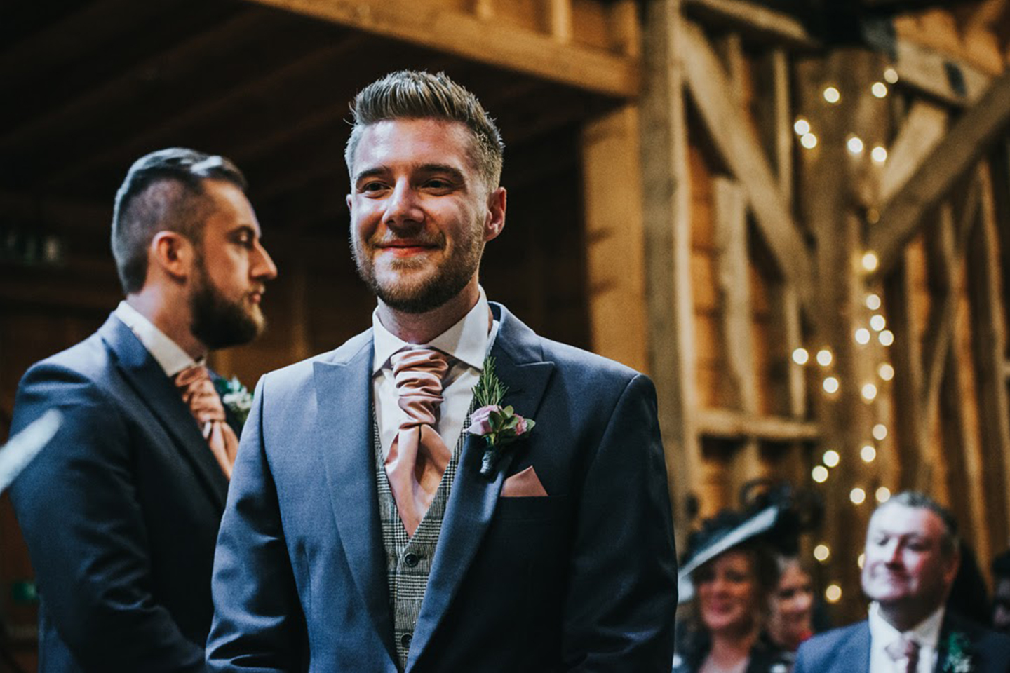 The groom wore a navy wedding suit for his wedding day at Bassmead Manor Barns