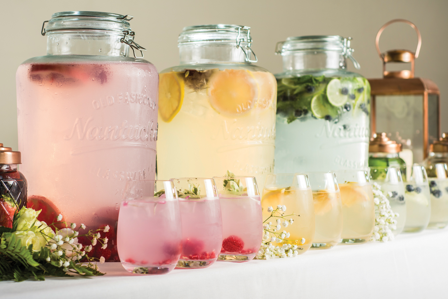 A selection of mocktails is available to guests after a wedding ceremony at Bassmead Manor Barns