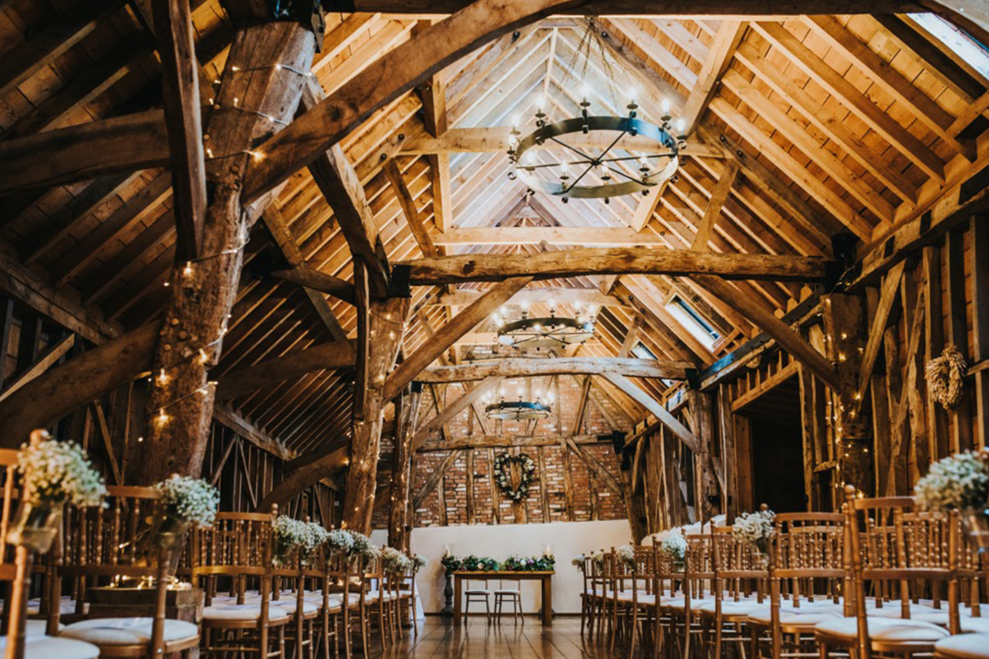 The Rickety Barn at Bassmead Manor Barns is set up for a rustic wedding ceremony