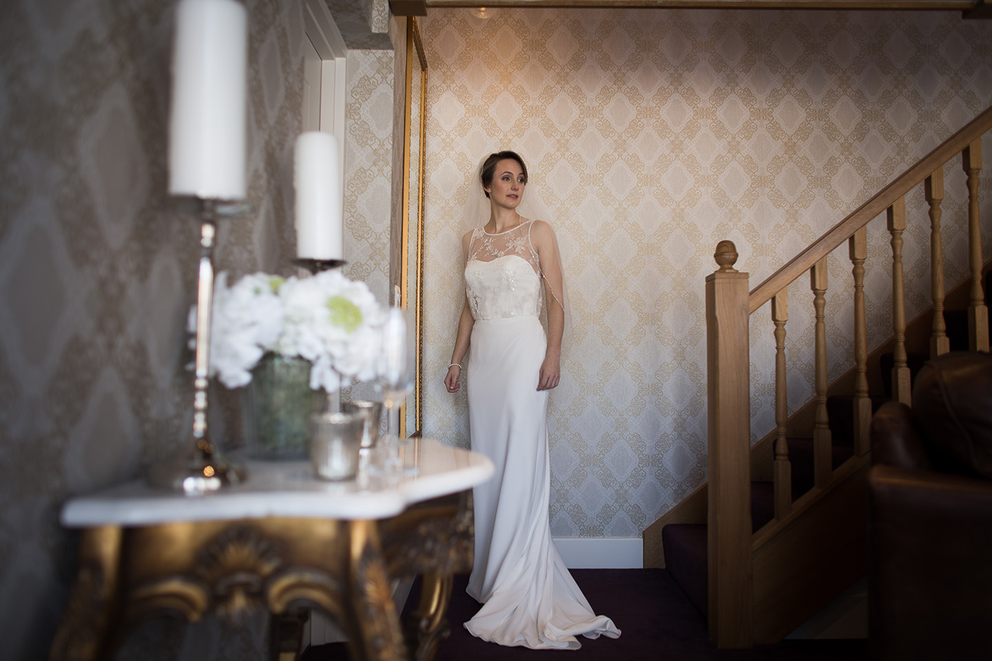 The bride wore a slim fitting fishtail gown for her spring wedding at Bassmead Manor Barns